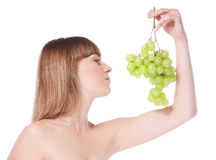 Beautiful young woman with green grape Royalty Free Stock Photo