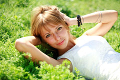 Beautiful young woman on the green meadow Stock Photo
