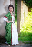 Beautiful young woman in green medieval dress Stock Photos