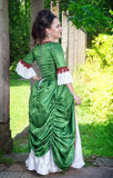 Beautiful young woman in green medieval dress Royalty Free Stock Photography