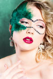 Beautiful young woman in a green mysterious venetian mask a new year carnival, Christmas masquerade, a dance club, secret nigh Stock Images