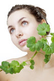 Beautiful young woman with a green plant Stock Photo