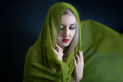 Beautiful young woman in green summer shawl Royalty Free Stock Image