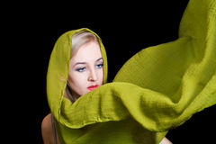 Beautiful young woman in green summer shawl. Isolated on black background Royalty Free Stock Photo