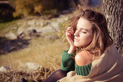 Beautiful young woman in green sweater and shawl Royalty Free Stock Image