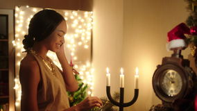 Beautiful young woman greeting her friend on the phone with New Year stock footage