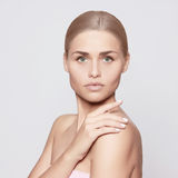 Beautiful young woman. Groomed young girl with beautiful skin Royalty Free Stock Images