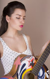 Beautiful young woman with guitar Royalty Free Stock Photography