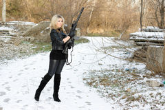Beautiful young woman with a gun Royalty Free Stock Photo