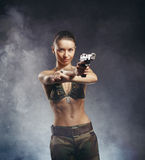 Beautiful young woman with gun Royalty Free Stock Images