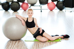 Beautiful young woman on gym Stock Image