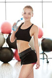 Beautiful young woman on gym Stock Photo
