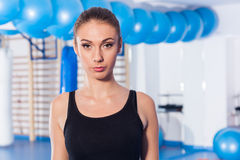Beautiful young woman in gym. Gym shot. Crossfit hall. Royalty Free Stock Images
