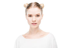 Beautiful young woman with hair buns looking at camera Royalty Free Stock Image