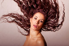 Beautiful young woman hair flip Royalty Free Stock Photos
