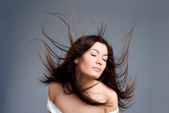 Beautiful young woman with hair flying Stock Photos