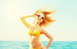 Beautiful young woman with hair flying in the wind and sunglasse Stock Photos