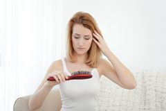 Beautiful young woman with hair loss problem. At home Stock Photography