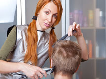The beautiful young woman the hairdresser Royalty Free Stock Image