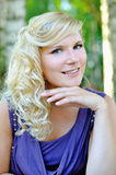 Beautiful young woman with hairstyle outdoors Royalty Free Stock Photo