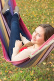 Beautiful young woman in hammock Stock Photos