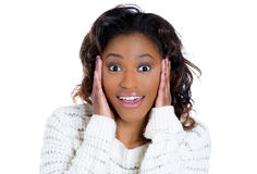 A beautiful young woman with hand on cheek in surprise and disbelief. Closeup portrait of a happy cute young beautiful woman looking shocked and surprised in Royalty Free Stock Images