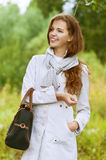 Beautiful young woman with handbag Stock Photos