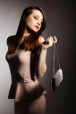 Beautiful young woman with handbag. royalty free stock images