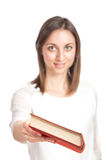 Beautiful young woman handing out red book Royalty Free Stock Images