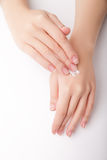 Beautiful young woman hands with cream Stock Images