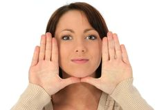 Beautiful Young Woman With Hands Framing Face Royalty Free Stock Images