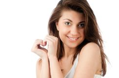 Beautiful young woman, hands in shape of heart Royalty Free Stock Photography