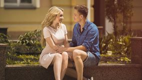 Beautiful young woman and handsome man looking at each other tenderly, love. Beautiful young women and handsome men looking at each other tenderly, love, stock Stock Image