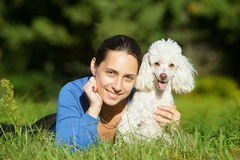 Beautiful young woman and happy dog Stock Photos