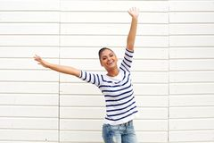 Beautiful young woman with happy expression and arms raised Royalty Free Stock Images