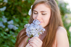 Beautiful young woman happy smiling & flowers Stock Photography