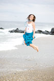 Beautiful young woman has fun on the ocean shore Royalty Free Stock Photography