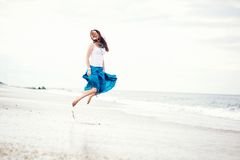 Beautiful Young Woman Has Fun On The Ocean Shore Royalty Free Stock Image