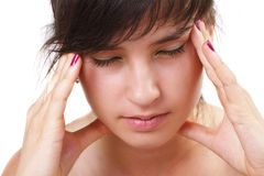 Beautiful young woman has a headache Stock Photo