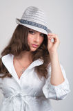 Beautiful Young Woman in Hat Stock Photography