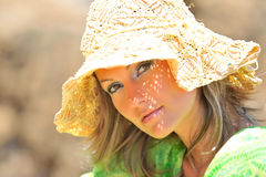 Beautiful young woman with hat Stock Photography