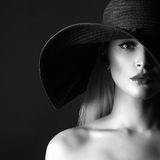 Beautiful young woman in hat Stock Image