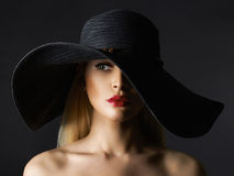 Beautiful young woman in hat Royalty Free Stock Photography