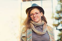 Beautiful young woman in hat and glasses stock image