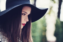 Beautiful Young Woman in a Hat Outdoors Royalty Free Stock Photo