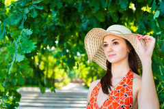 Beautiful young woman in hat Stock Photos