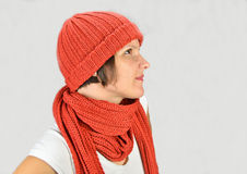 A beautiful young woman with a hat and a scarf Stock Photography