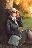 Beautiful young woman in hat and scarf enjoy sunlight Royalty Free Stock Photo