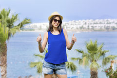 Beautiful young woman with hat on a  sea background.Summer holidays Royalty Free Stock Image