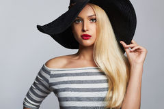 Beautiful young woman in hat. summer fashion blond girl Stock Image